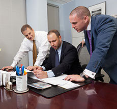 Mortgage loan originators at Silver Fin Capital at work.